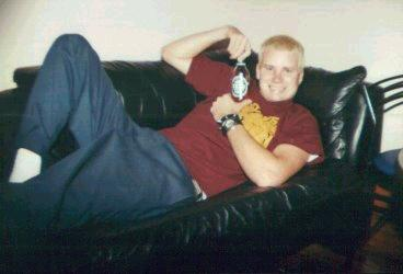 Tom....holding beer?!? LOL!! *Quick Fact* Tom was once kicked out of high school for drinking beer at a basketball game!