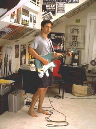 "Jesse playing the guitar in ""Bring It On!"" *Quick Fact* Jesse wants to eventually play guitar with Van Morrison!"